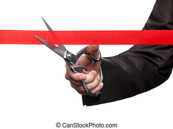 Grand ceremony of opening - A business man cutting a scarlet...