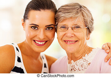 woman and senior mother closeup - happy woman and senior...