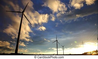 Wind power generators are against the setting sun