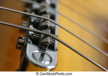 Music - Detail of the bridge on a modern electric guitar