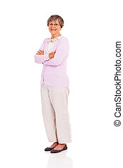 senior woman full length portrait standing on white...