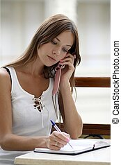 woman calling by phone?