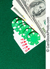 Royal Flush poker card sequence with money and chips