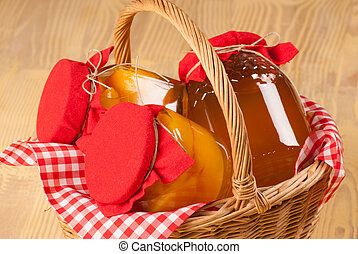 Harvest basket - Basket full of jars with recent harvest...