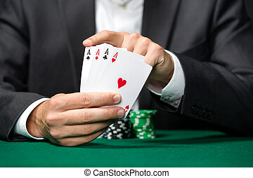 Poker player shows poker cards 4 aces