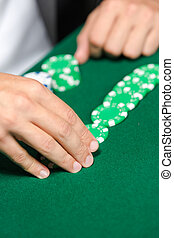 Gambler puts the poker chips on the table