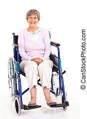 elderly woman sitting on wheelchair - happy elderly woman...