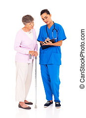 nurse explaining medical test result to senior patient