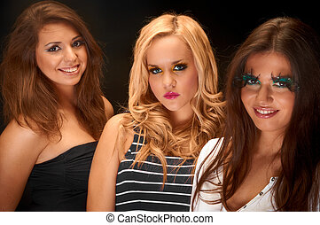 A group of young models against dark background