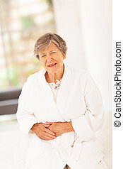 senior woman feeling sick at home