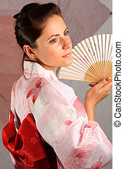 Kimono Girl 2 - A photograph of a young girl wearing pink...