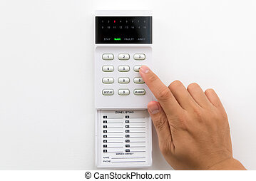 Home security alarm - Hand is setting home security alarm...