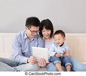 happy family using tablet pc - A happy, family of mother,...