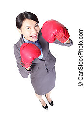 business woman punching by boxing gloves