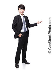 Young handsome Business man presenting in full length...