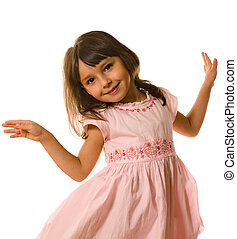 Dancing little girl in pink clothes on white