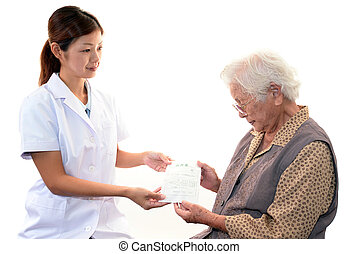 Pharmacist with old woman - Pharmacist with a patient...
