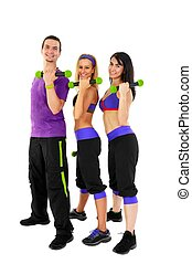 Young Fitness Instructors against white background in studio