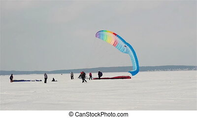 Snow-kiting on a frozen lake