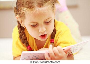 Girl reading - Cute little girl reading a book