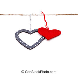 two hearts hung up on the string isolated over white