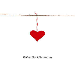 red heart hung up on the string isolated over white