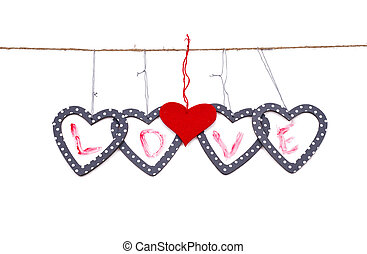 five hearts with the word love hung up on the string...