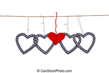 five hearts hung up on the string isolated over white