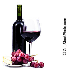 wine glass with red wine, bottle of wine and grapes isolated...