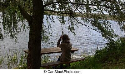 girl tree bench lake hair - woman girl sit on bench under...