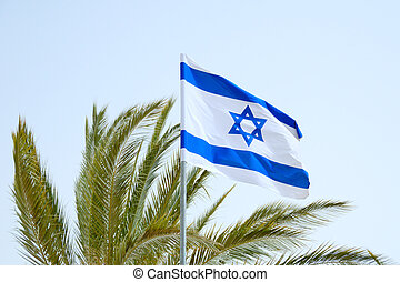 Flag of Israel. - Israel's flag float on the wind against a...