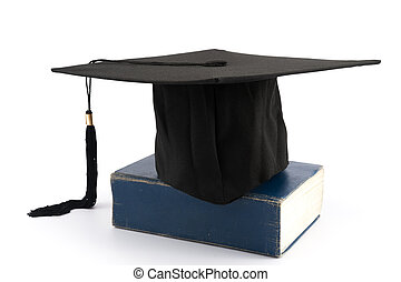 Graduation cap on a thick book
