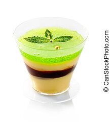Fresh fruit jelly with green mint isolated