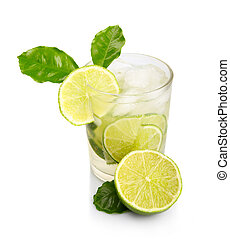 Full glass of fresh cool tonic with lime fruits isolated