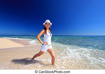 Woman doing exercises on beach