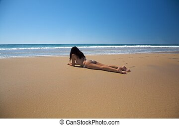 bikini woman lie down on the sand - woman bikini dressed at...