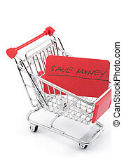 Save money words written on red paper card in shopping cart...