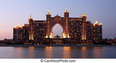 Atlantis Hotel illuminated at night. Palm Jumeirah, Dubai...