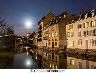 Moon over Ill river in Petite France area, Strasbourg -...