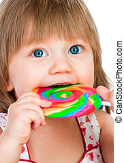 Baby girl eating a sticky lollipop on white background