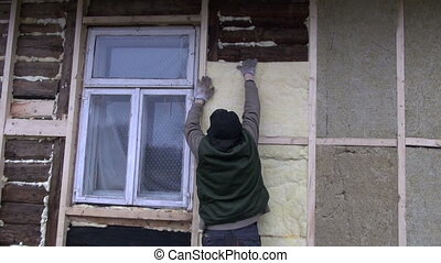 old rural house wall insulation with mineral rock wool works...