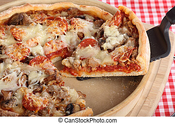 Slice of Deep Dish Pizza - Slice of deep dish sausage and...