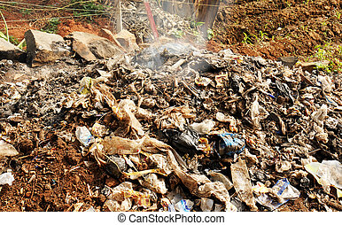 Burning waste or garbage in Africa - Pile of rubbish,...