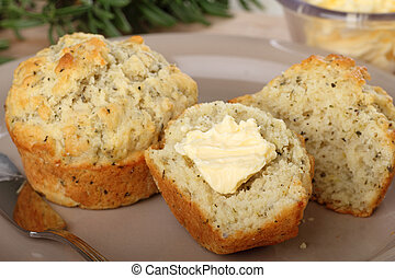 Buttered Herb Muffin - Herb muffins on a plate with one cut...