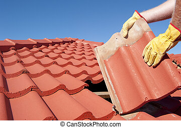 Construction worker tile roofing repair house - Roof...