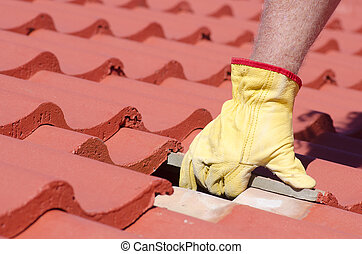 Tile roofing repair closeup - Roof repair, worker with...
