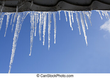 icicles against the blue sky