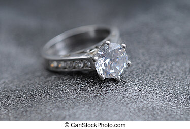 big diamond engagement ring - diamond ring on elegant gray...
