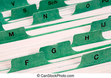 Staying Organized - Files with letter tabs for keeping...