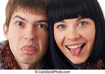 Sticking out tongue. Couple making funny silly face.